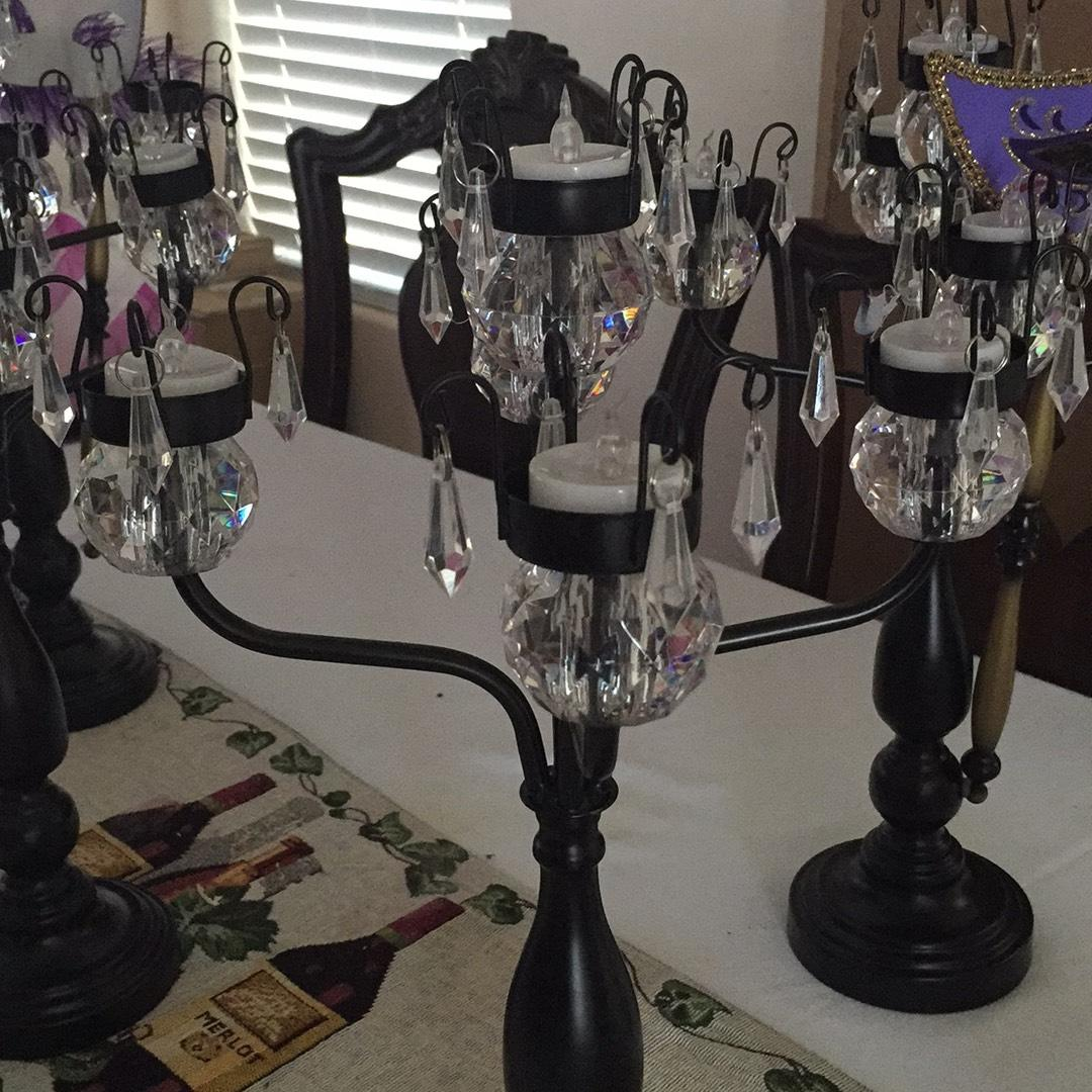 Elegant canddle holders used as center pieces for a party! They come with LED tea lights.