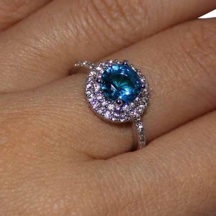 9.2.5 gorgeous blue and white topaz round cocktail ring size 7.