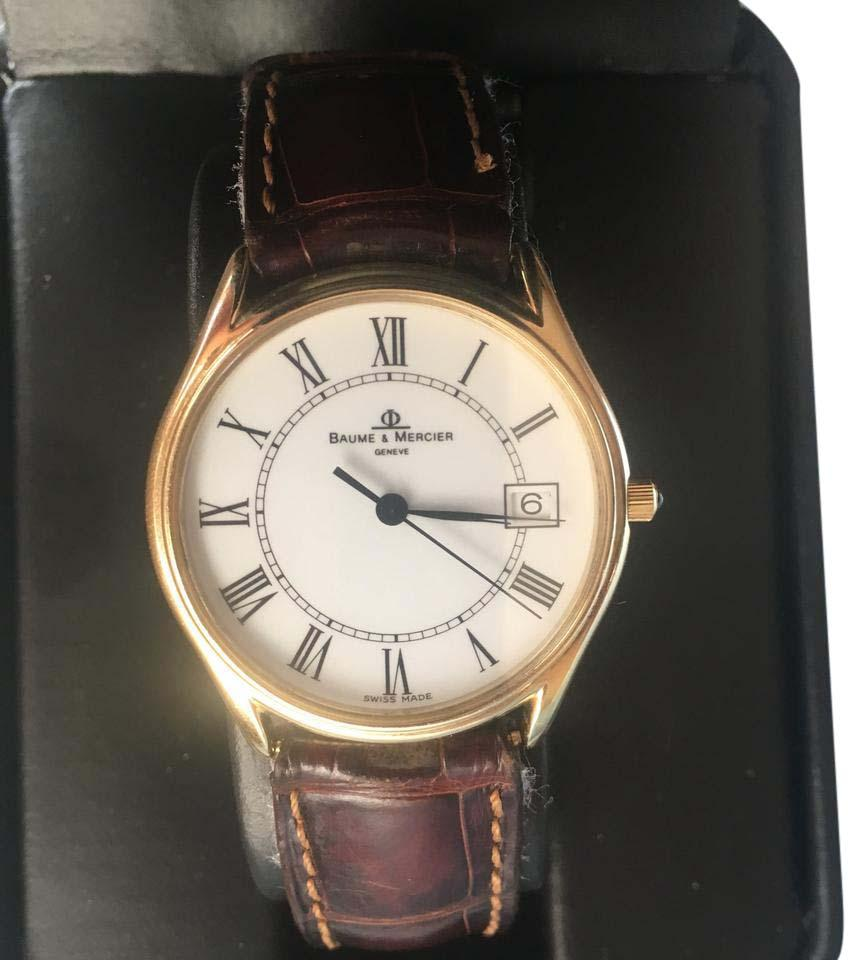 Baum & Mercier 14k gold men's watch, Baum & Mercier band, model 95248, excellent condition, no scratches.