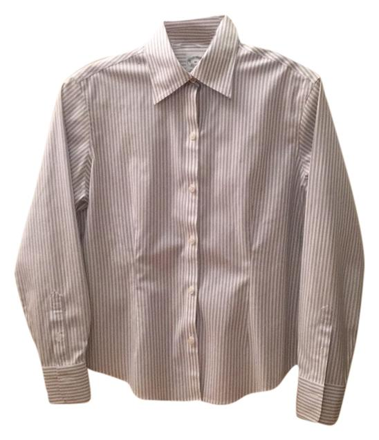 """The button down collar is non-fused and cotton lined, with a perfect roll. The spread collar fits comfortably and is deep and wide enough to lie properly under the lapels of a jacket. Every collar is designed with the proper tie space, thereby eliminating the dreadful appearance of a """"gap"""" between the tie and the shirt collar."""
