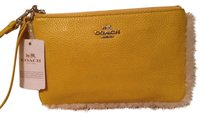 Coach Wristlet in Yellow And Silver