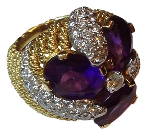 Custom design by a Dallas jeweler in the 1990s. Never worn.