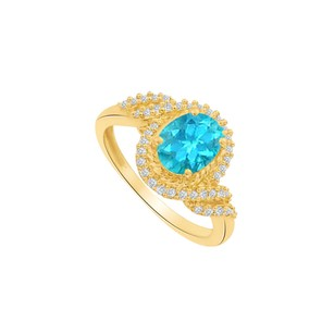Fine Jewelry Vault Blue Topaz and CZ Twisted Shank Ring in 14K Yellow Gold