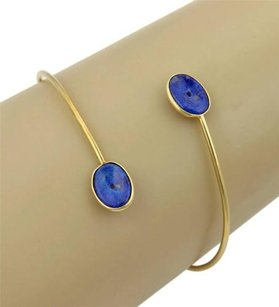Gucci Gucci 18k Yellow Gold Lapis Cross Over Wire Bangle Bracelet