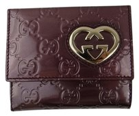 Gucci Gucci Patent Guccissima Leather Interlocking GG Heart Small Wallet 299924