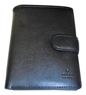 Gucci men's black Gucci leather wallet with many compartments w/box