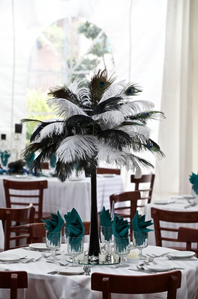 Black feather centerpieces and candelabras off