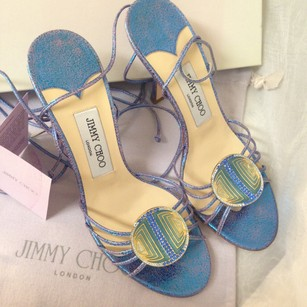 Jimmy Choo Monogram All Accessories Embellished Laceup Metallic blue/with pink/violet hues/ crackle/ emblem with added greens and ivory pearl/ gold edging with royal and light blue stones. Sandals