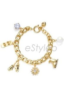 Juicy Couture Juicy Couture Charm Bracelet Winter Skate Mitten Snowflake Crystal Gold