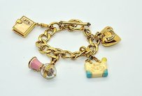Juicy Couture Juicy Couture Gold Toned Charm Bracelet