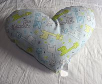 Lisa Nieves Adorable giraffe print heart shaped pillow. Soft to the touch. Measure