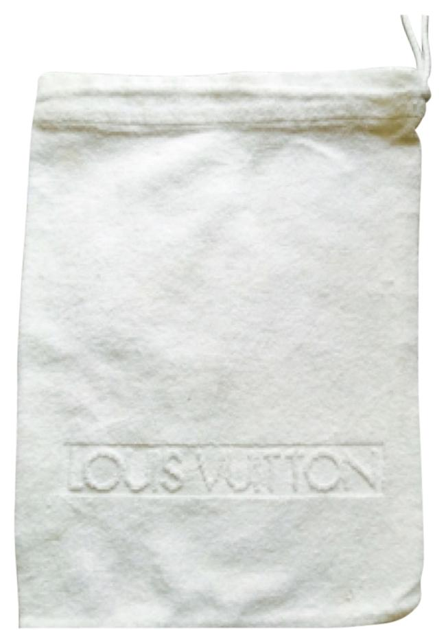 Louise Vuitton White dust bag for spa sandels