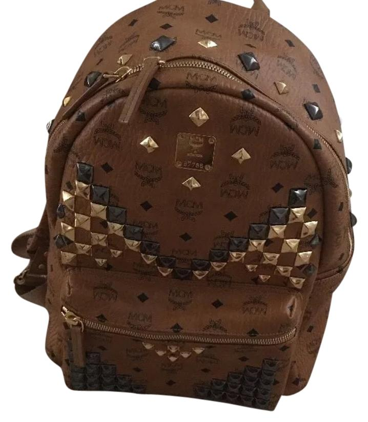 mcm studded backpack with receipt dustbag
