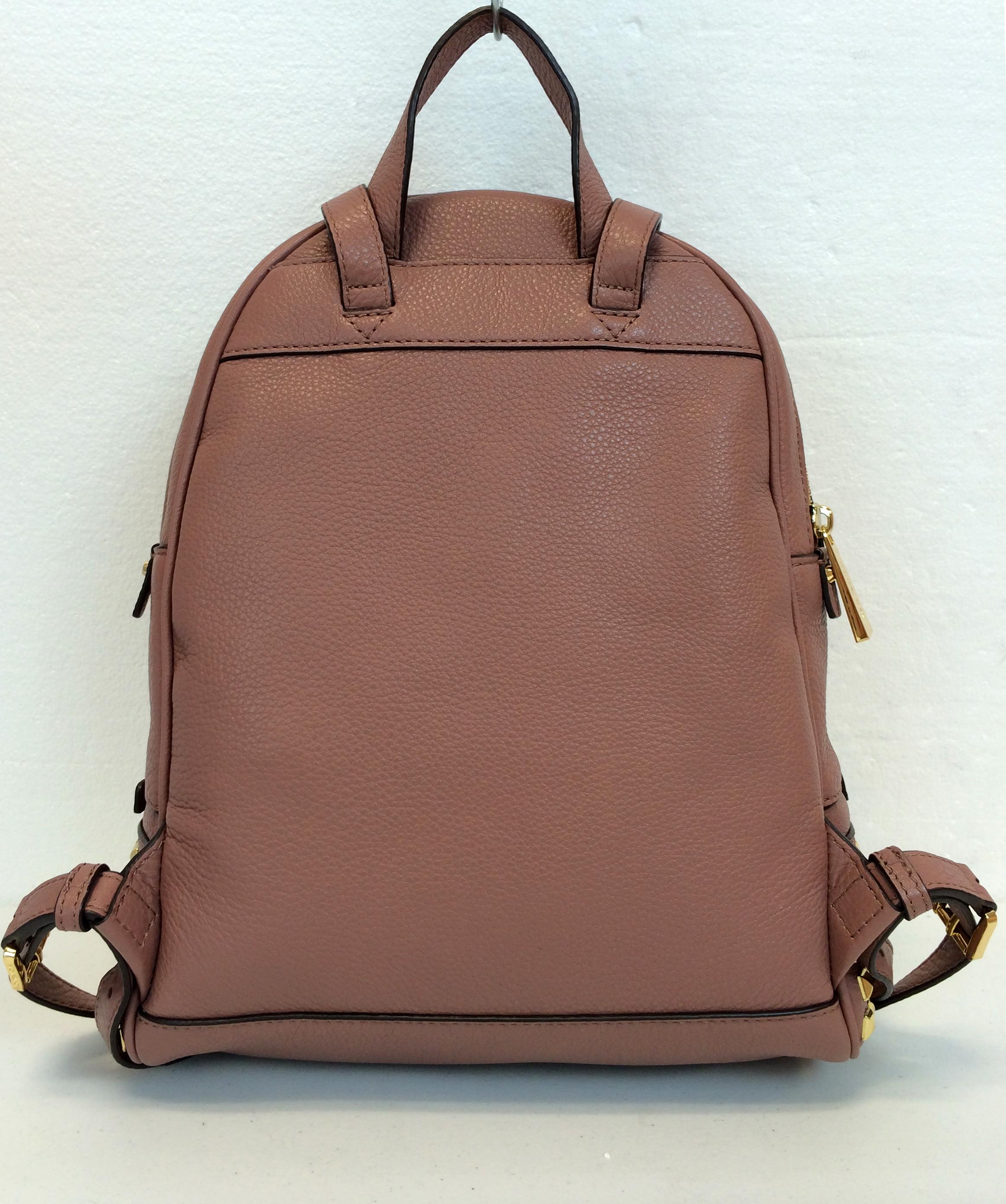 05ae62adf4e7 ... official store michael kors studded small rhea leather backpack.  123456789101112 e5fee 7af0b