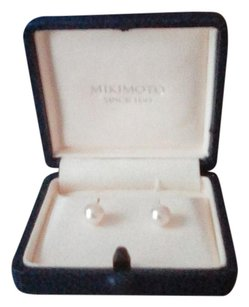 Mikimoto Mikimoto Akoya cultured pearl stud earrings set in 18k yellow gold.