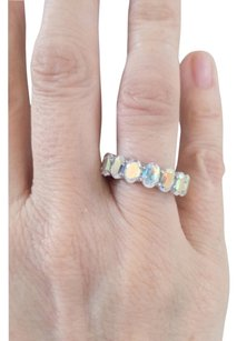 Nyc II by Chuck Clemency for Evine Opalescent topaz Eternity Band