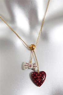Chanel 2002 Red Heart Gemstone Logo Detail Bow Charm Gold Tone Choker Necklace