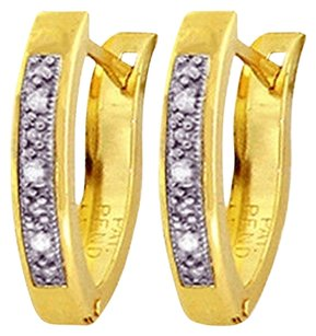 0.04 CT Diamond 14k Yellow Gold Oval Huggie Earrings