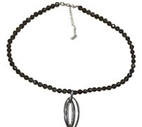 Other Quartz like beaded necklace with silver and crystal pendant.