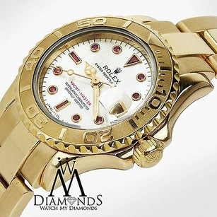 Rolex Ladies Rolex Yacht-master 18kt Yellow Gold Mop Factory Ruby Dial Watch 69628