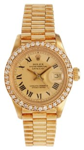 Rolex Rolex Datejust 18K Yellow Gold Custom Diamond Bezel Champagne Dial Ladies Watch