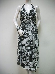 Social Occasions by Mon Cheri short dress Multi-Color Black White Floral Print Halter 110835 on Tradesy