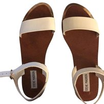Steve Madden white with gold trim and brownish soles Sandals