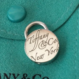Tiffany & Co. Tiffany & Co Silver New York Script Notes Round Charm (Open and Close) Lock