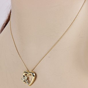Tiffany & Co. Tiffany Co. Elsa Peretti 18k Yellow Gold Heart Pendant With Bow Necklace