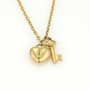 Tiffany & Co. Tiffany Co.18k Yellow Gold Puff Heart Lock Key Pendant Necklace